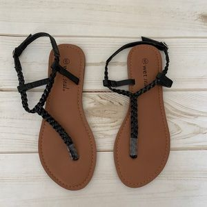 Black thong sandals by Wet Seal